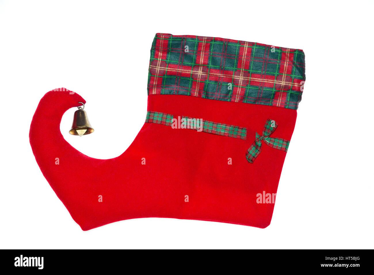 Weihnachtssocke mit Glocke, wie ein Schlitten isoliert auf weißem ...