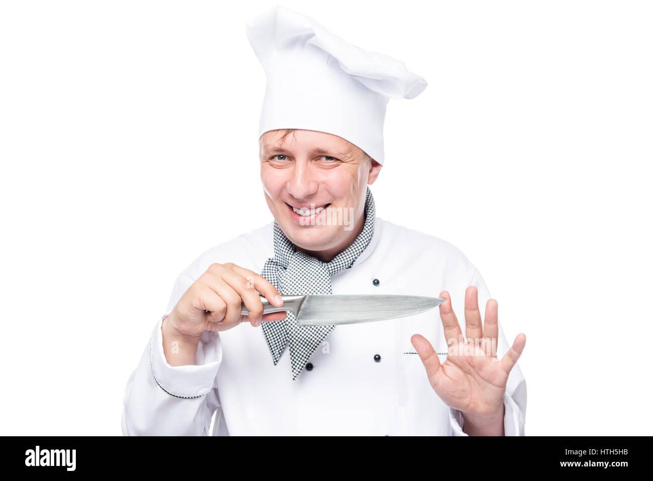 Kochen Sie in einem Anzug halten Sie ein scharfes Messer und geheimnisvoll lächelnd isoliert Stockbild