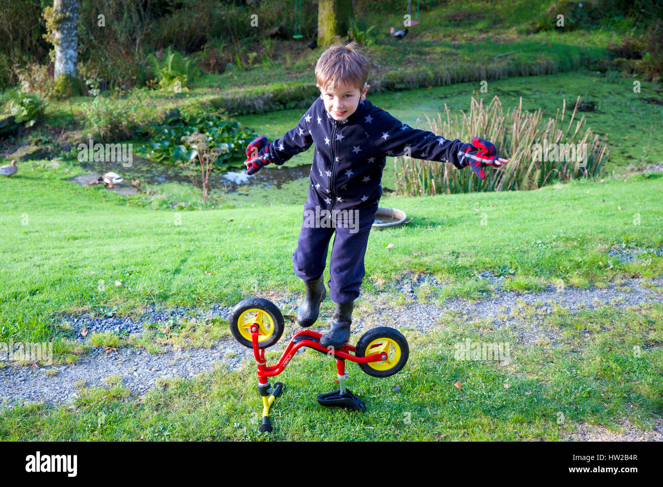 little boy playing bike outdoors stockfotos little boy playing bike outdoors bilder alamy. Black Bedroom Furniture Sets. Home Design Ideas