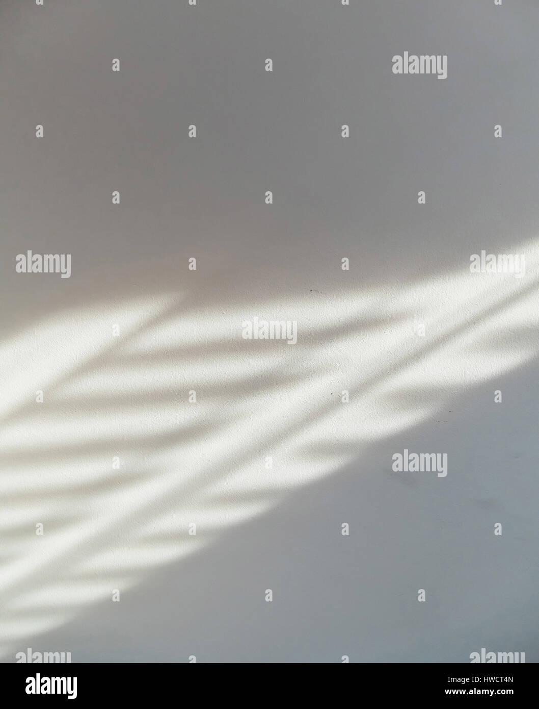Muster eines Vorhangs auf einer Mauer, Symbol für Sonne, Hintergrund, Muster, Muster Eines Vorhanges Auf Einer Stockbild