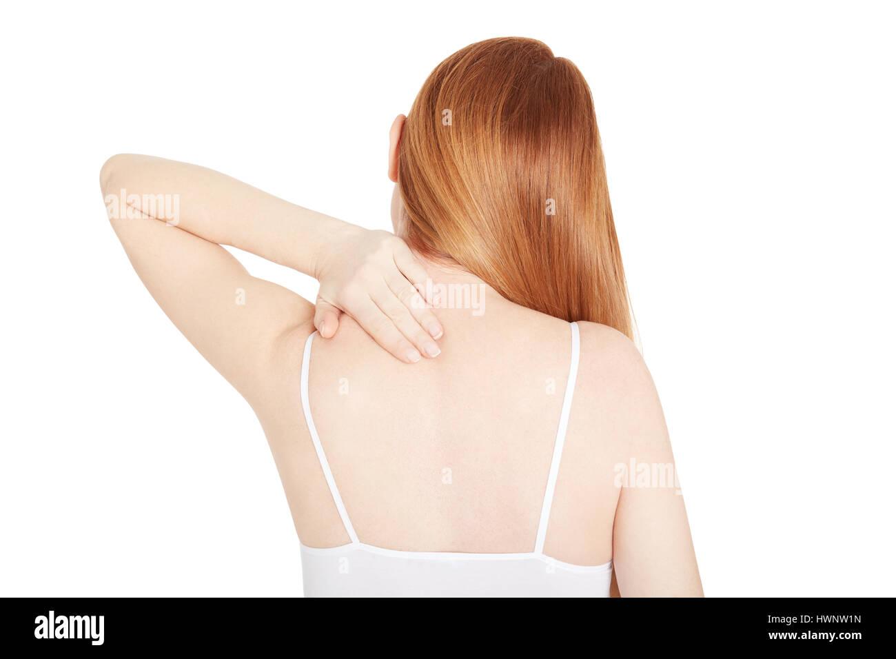 Frau mit Nackenschmerzen, isoliert auf weiss, Ansicht von hinten Schneidepfad Stockbild