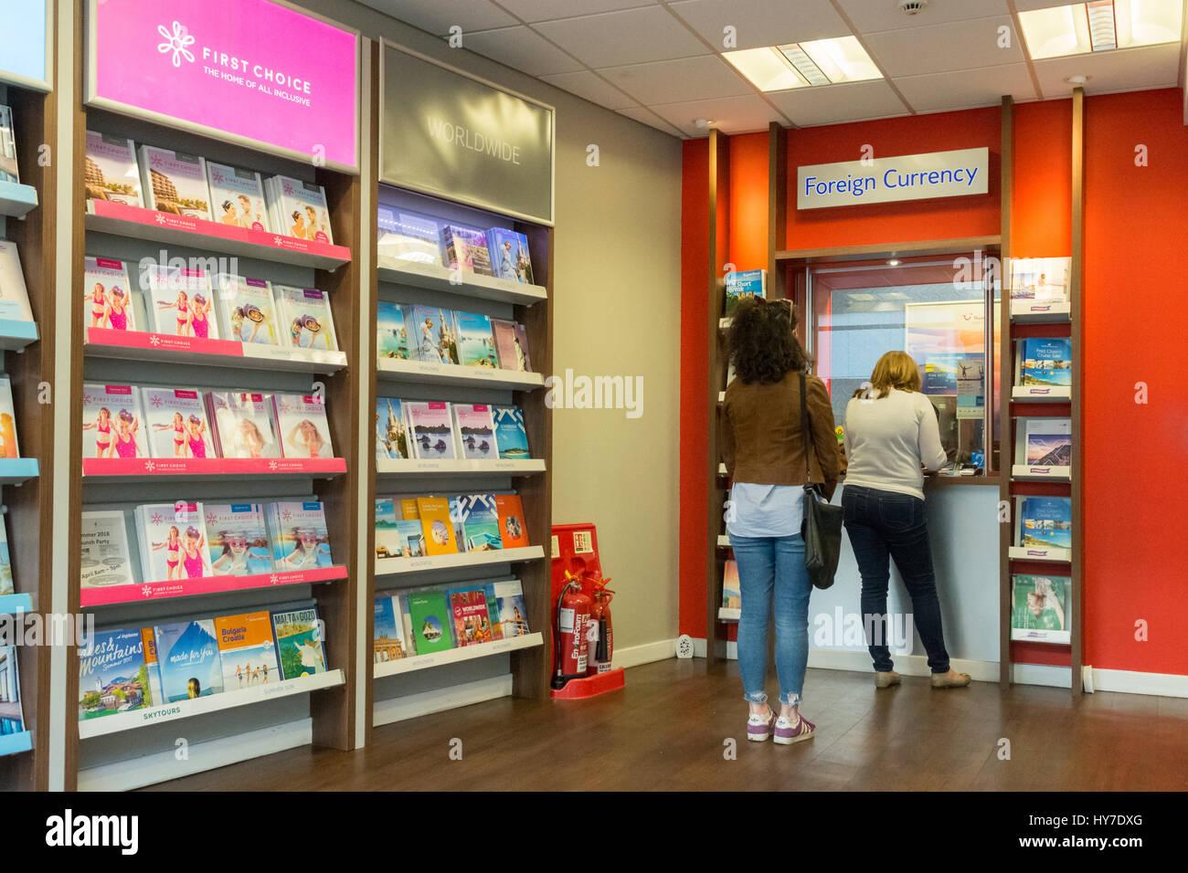 Thomson ausländische Währung Austausch Reisen Geld Reisebüro Geschäft innen innen Stockbild