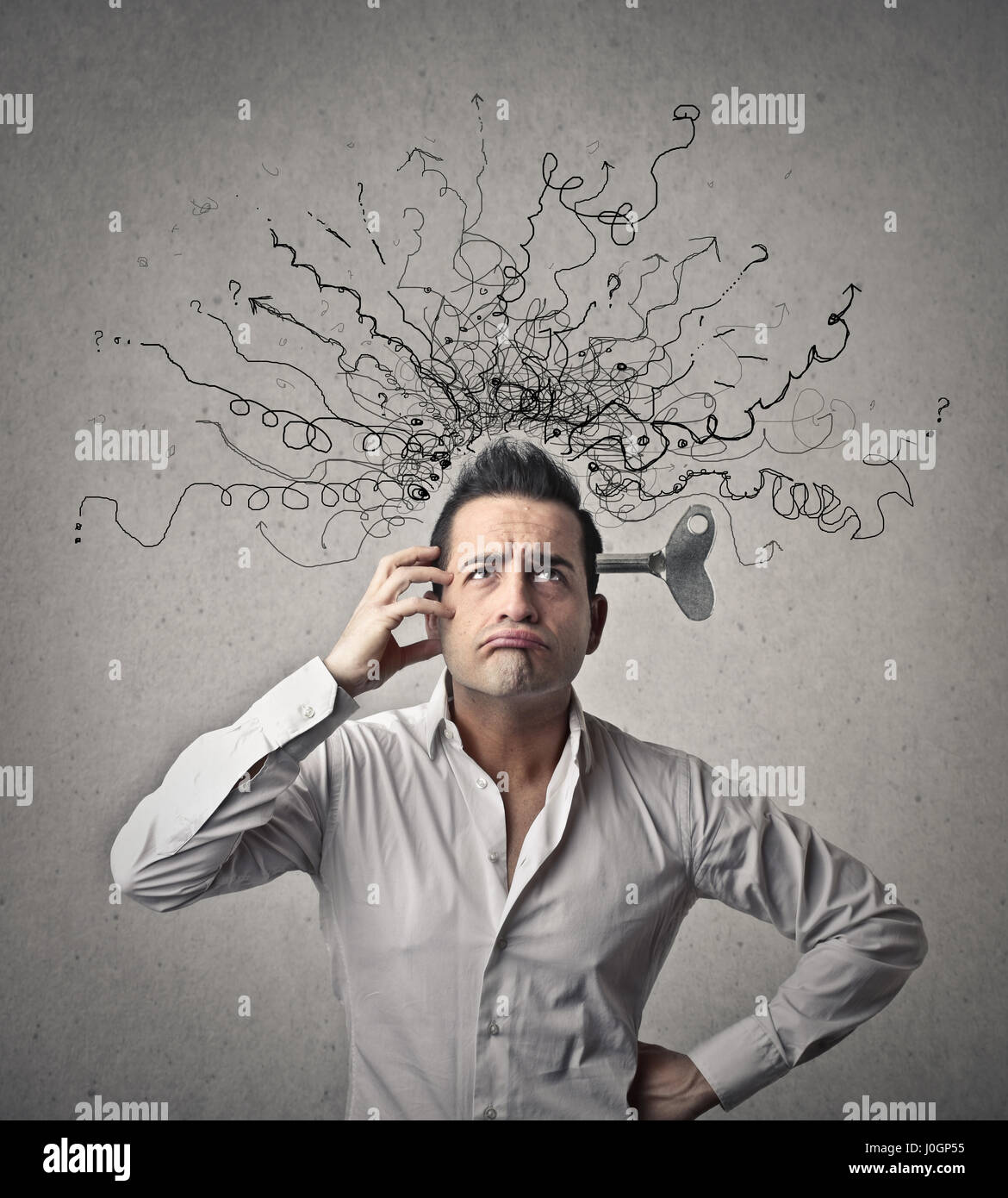 Geschäftsmann mit einem Durcheinander im Kopf Stockbild