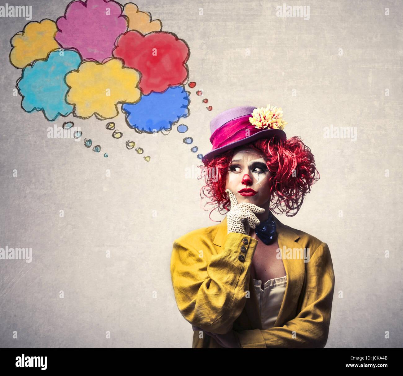 Clown Frau denken Stockbild