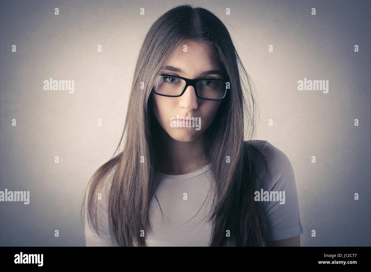 Junge Frau in Gläsern Stockbild