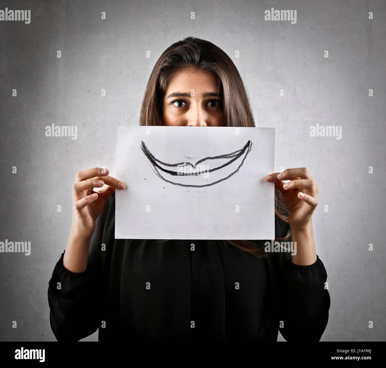 Frau mit gezogenen Mund auf Papier Stockfoto