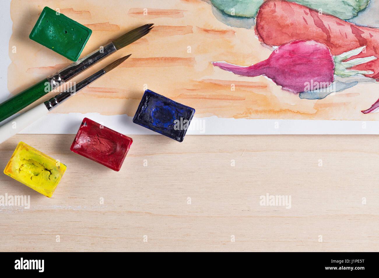 Stillleben Aquarell malen. Gemüse auf dem Küchentisch. Pinsel und ...