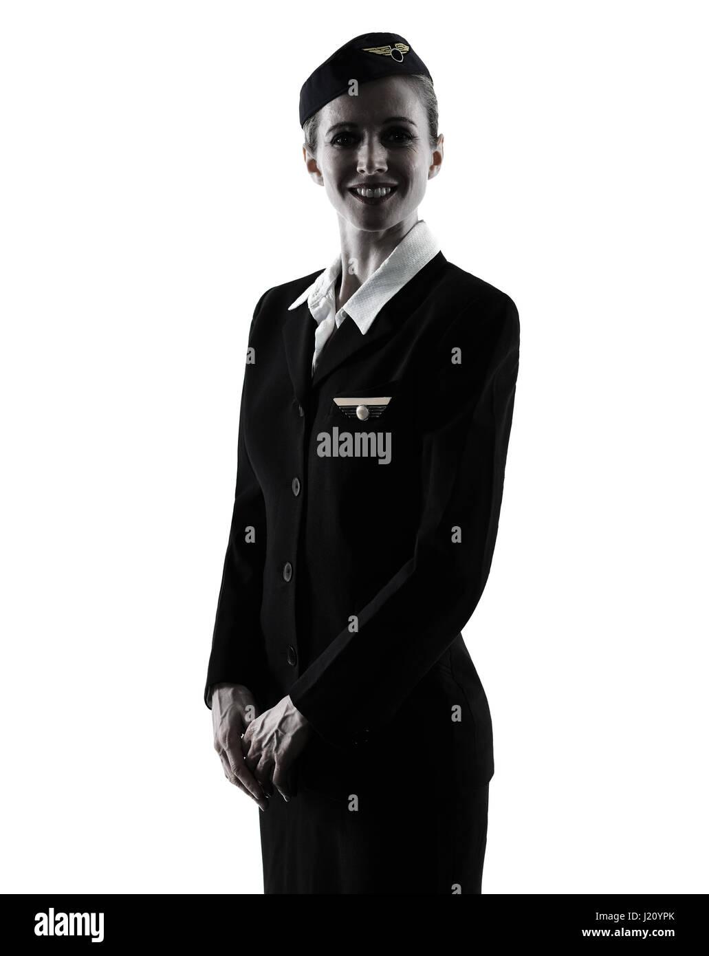 eine kaukasische Stewardess Kabine Crew Frau stand isolierten auf weißen Hintergrund in der silhouette Stockbild
