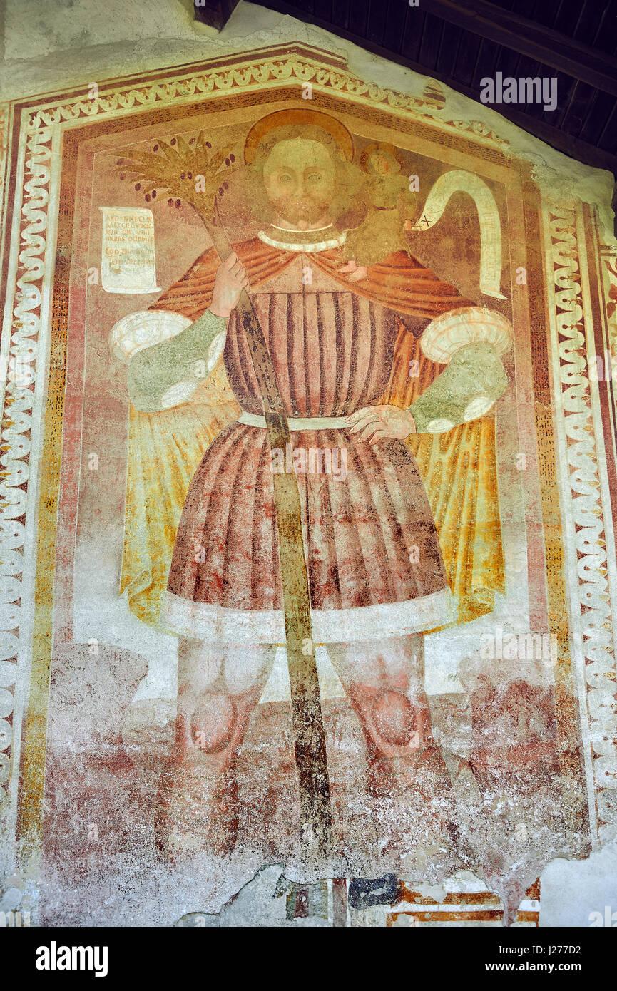 Religiöse Wandgemälde von St. Christopher mit Christus auf seinen Schultern durch Dionislo Baschenis datiert Stockbild