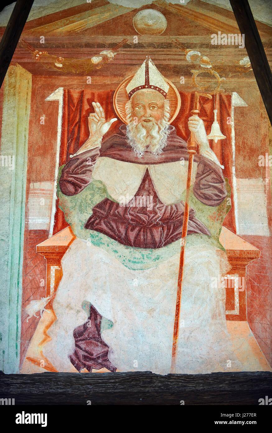 Religiöse Wandgemälde des Heiligen Antonio Abate ein Thron oben mit den kanonischen Symbolen einer Glocke Stockbild