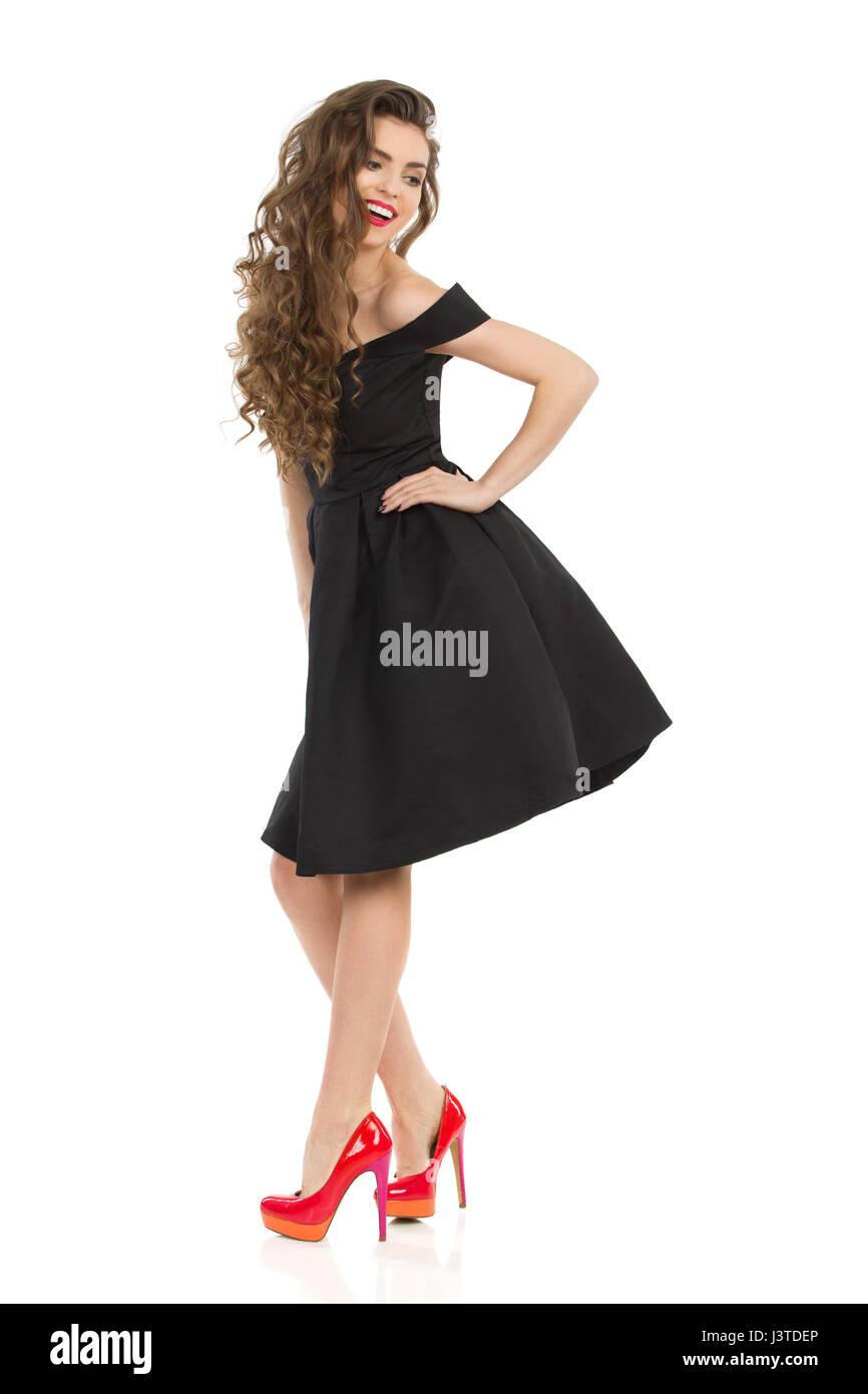 Black Dress Over Shoulder Stockfotos & Black Dress Over Shoulder ...