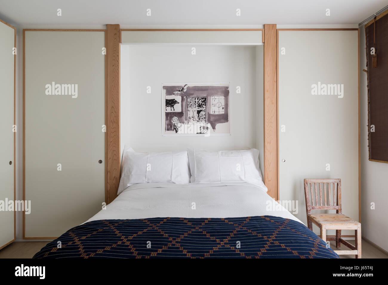Zen-artige Schlafzimmer mit weißem Laminat und Eiche, afrikanische ...