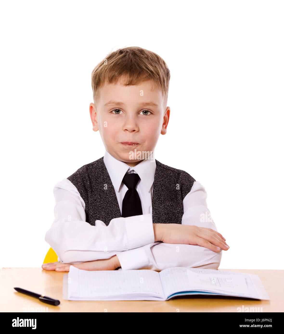 Schüler machen Hausaufgaben sitzen isoliert auf weiss Stockbild