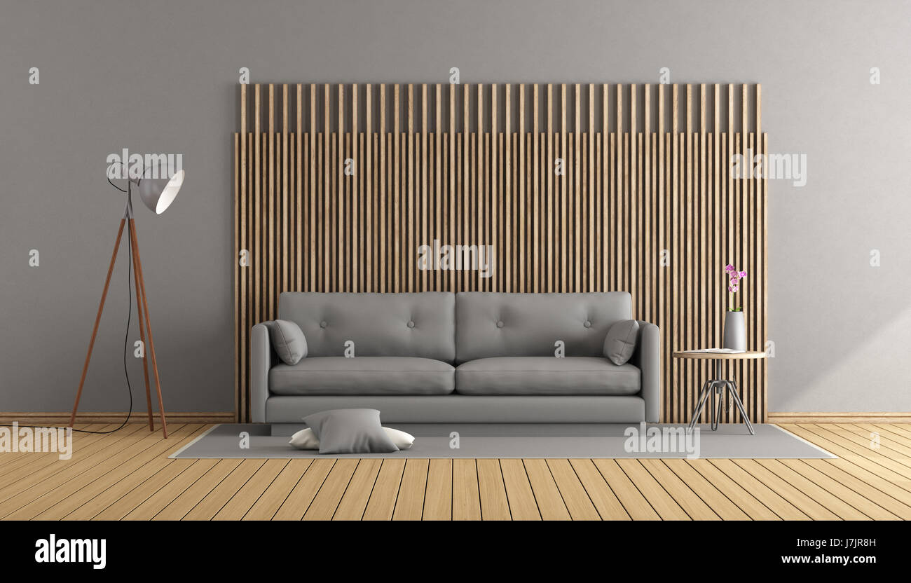 zeitgenössische Wohnzimmer mit grauen Sofa und dekorative Holzplatte ...