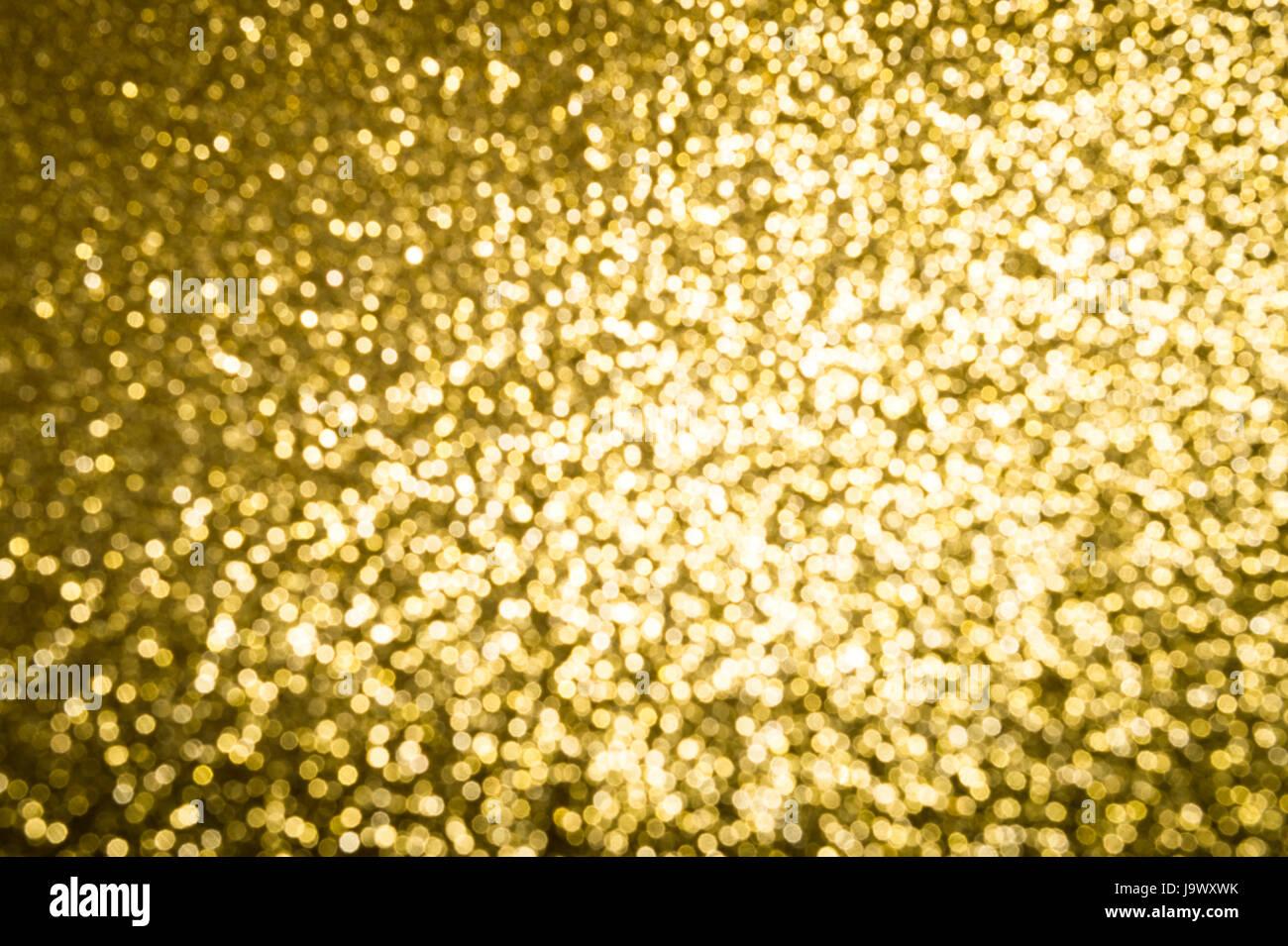 Abstrakter Hintergrund gold Glitter glänzend in unscharf gestellt Bokeh unter hellem Licht Stockbild