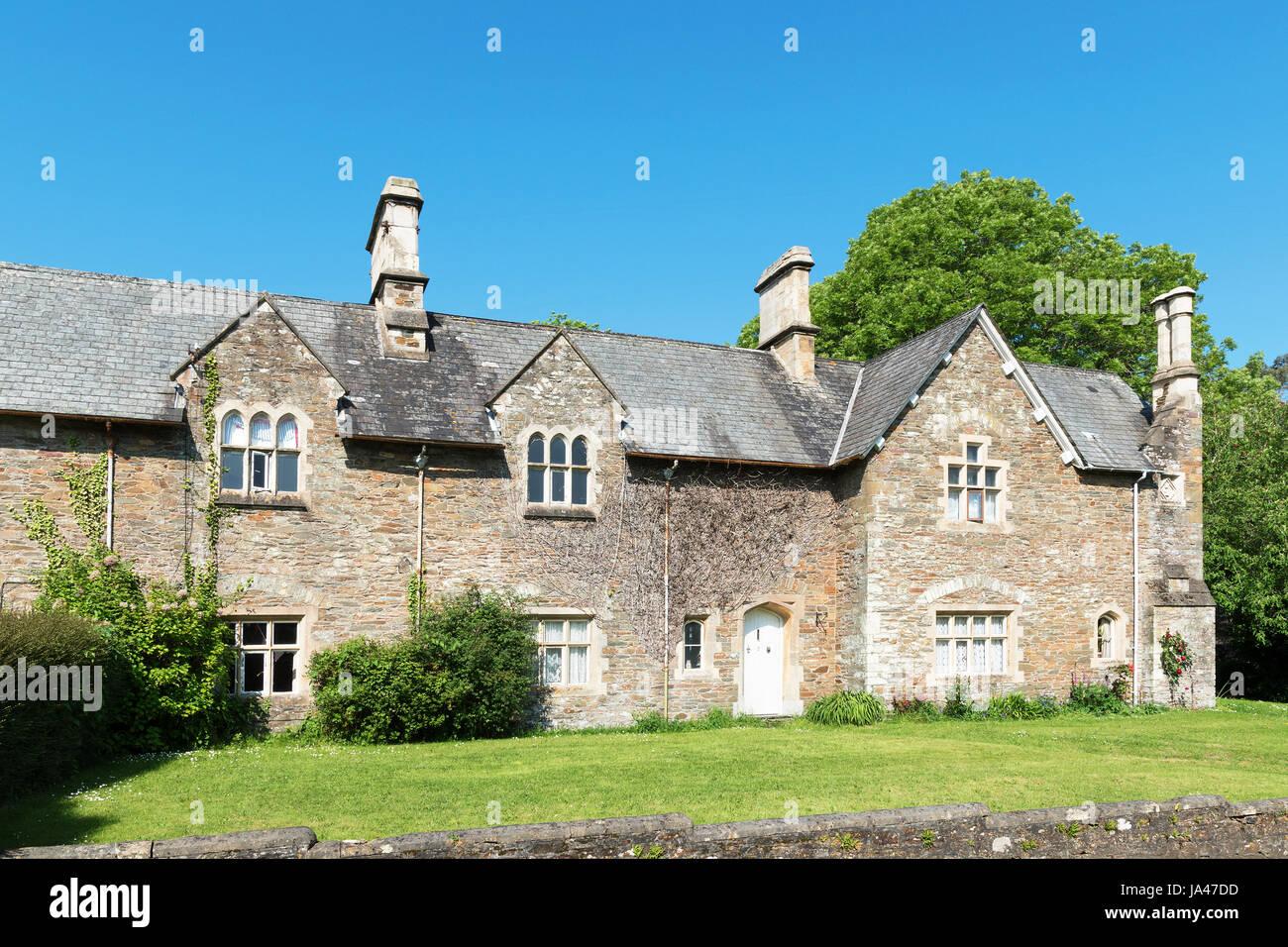 das alte Schulhaus umgebaut jetzt Häuser im Dorf von st.germans, Cornwall, England, Großbritannien, uk Stockbild
