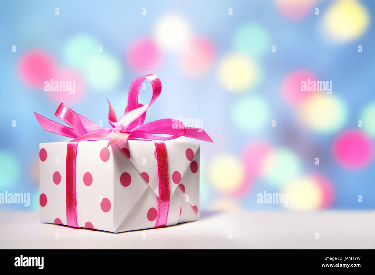 Geschenk-Paket, weiß-rosa Hintergrund leuchtet, Weihnachten ...