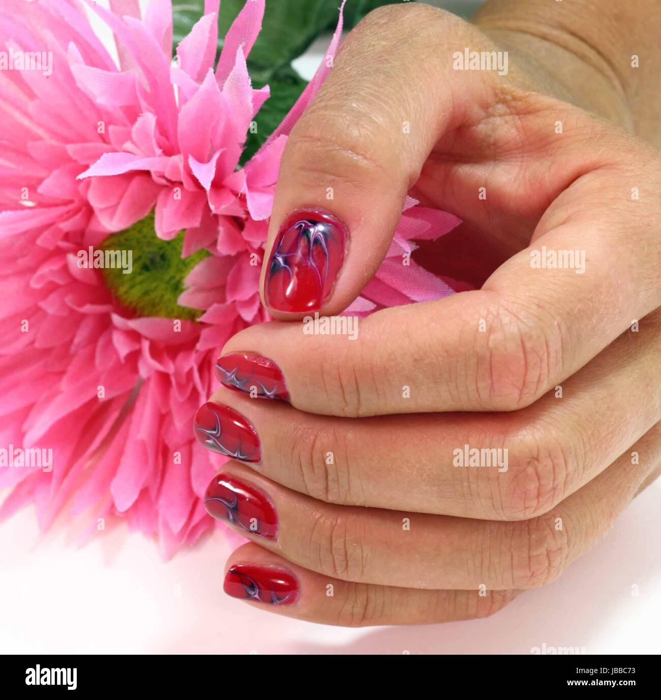 Female Hand Showing Red Nails Stockfotos & Female Hand Showing Red ...
