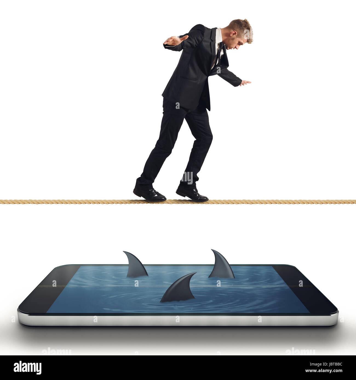 Unternehmer in Schwierigkeiten mit seinem smartphone Stockfoto