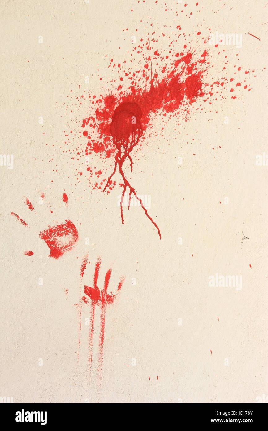 Farbkleckse Und Abdrücke von Händen Mit Roter Farbe Auf Einer Hellen Wand Stockbild