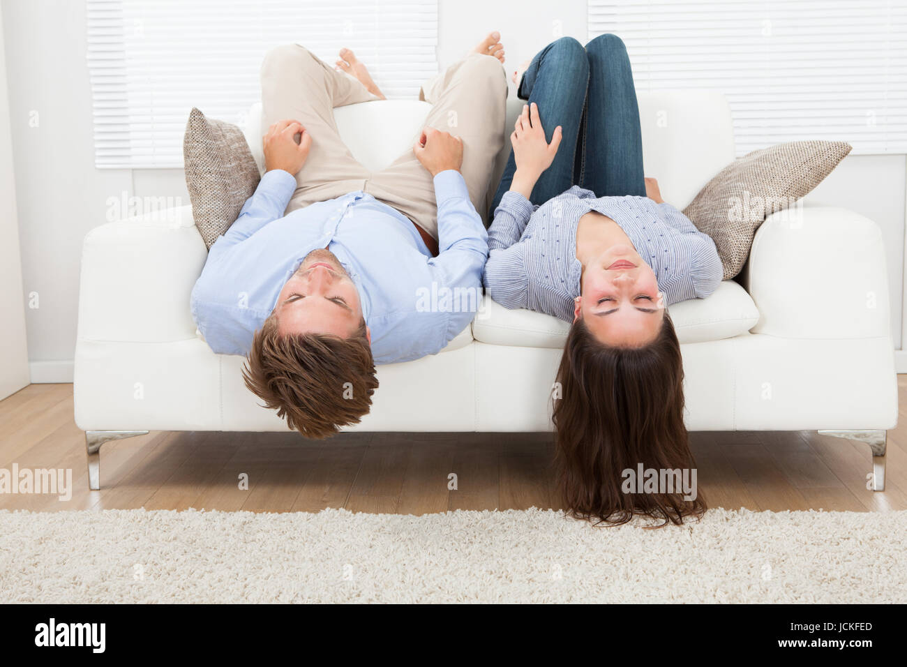 young woman sofa lying feet stockfotos young woman sofa lying feet bilder seite 3 alamy. Black Bedroom Furniture Sets. Home Design Ideas