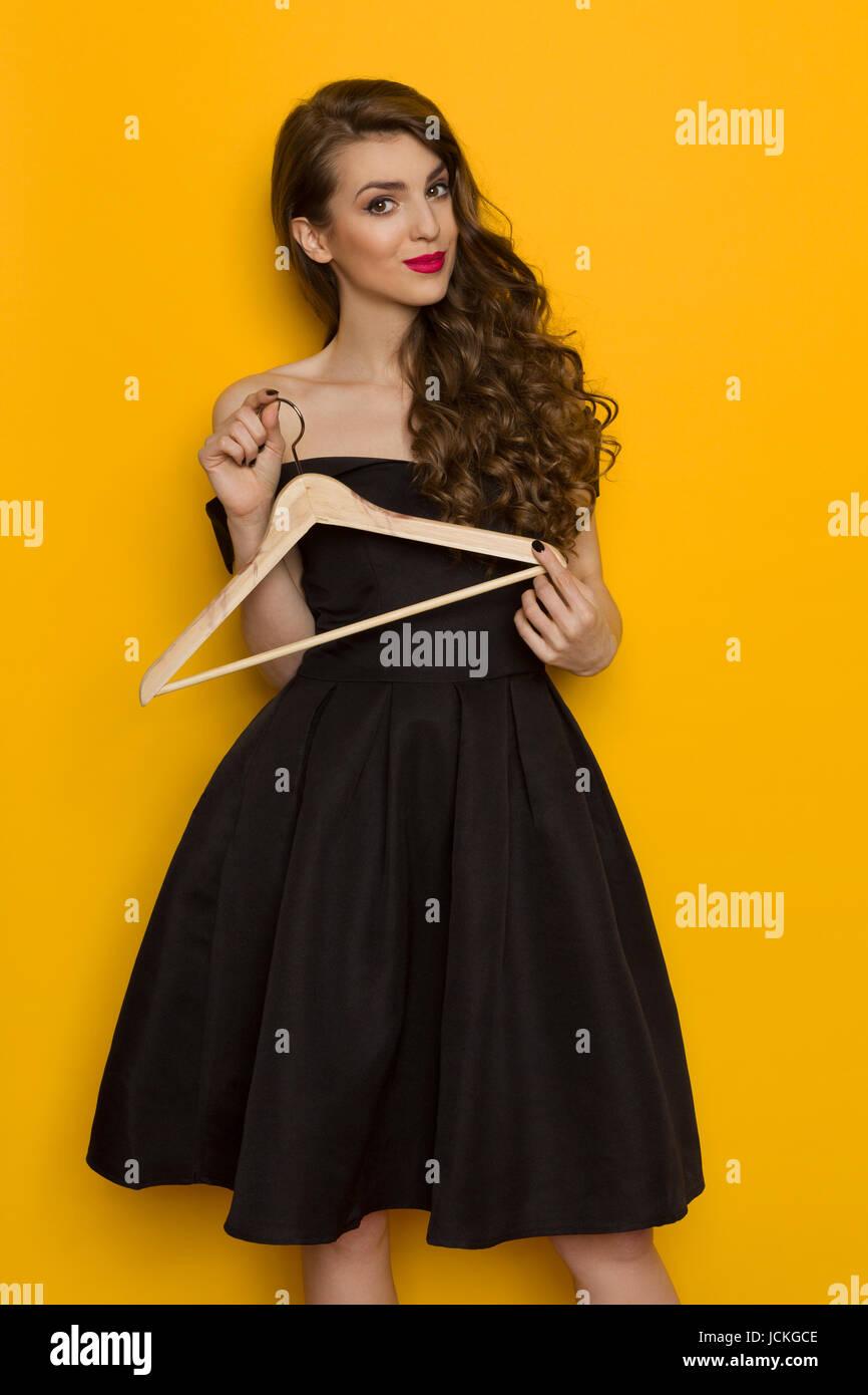 Girl Holding Dress On Hanger Stockfotos & Girl Holding Dress On ...