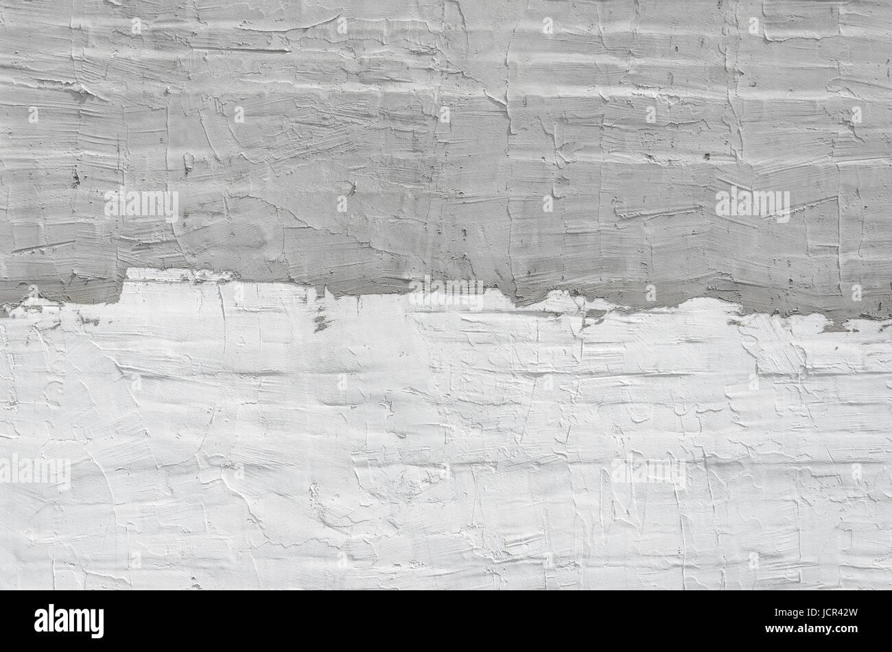 dünne schicht aus gips auf eine mauer. weiß und grau putz wand