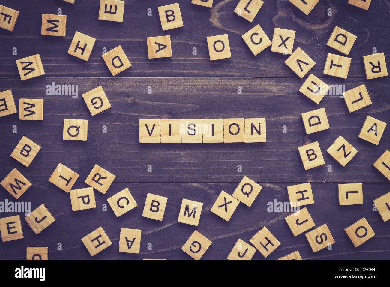 Vision-Wort auf Holztisch für Business-Konzept. Stockbild