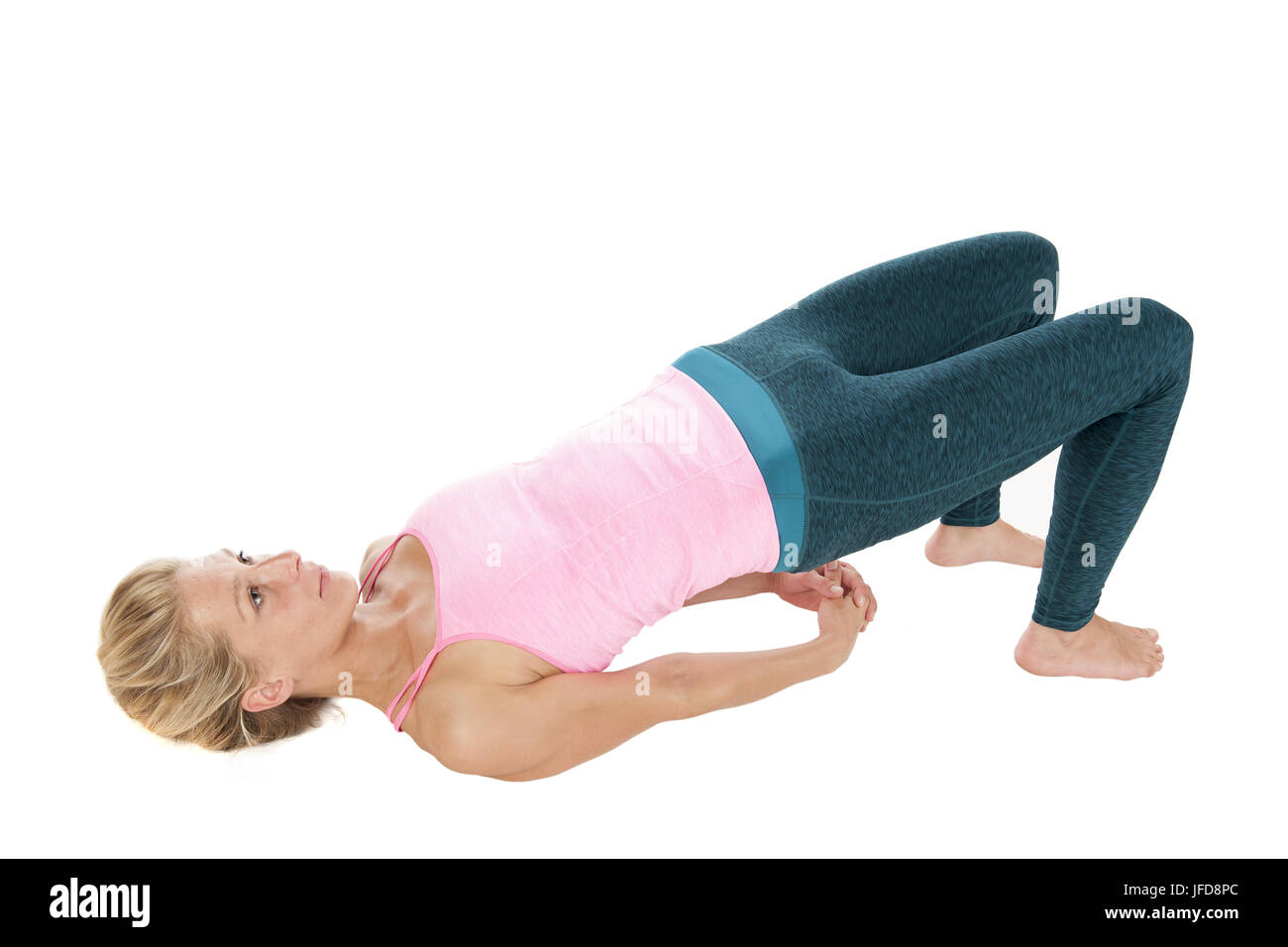 Yoga_Sethu Bandhasana_Profil_steigt_Seite Stockbild