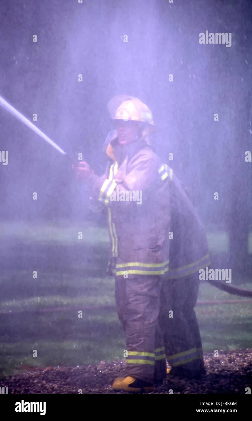 Feuerwehr in Simulationstraining Stockbild