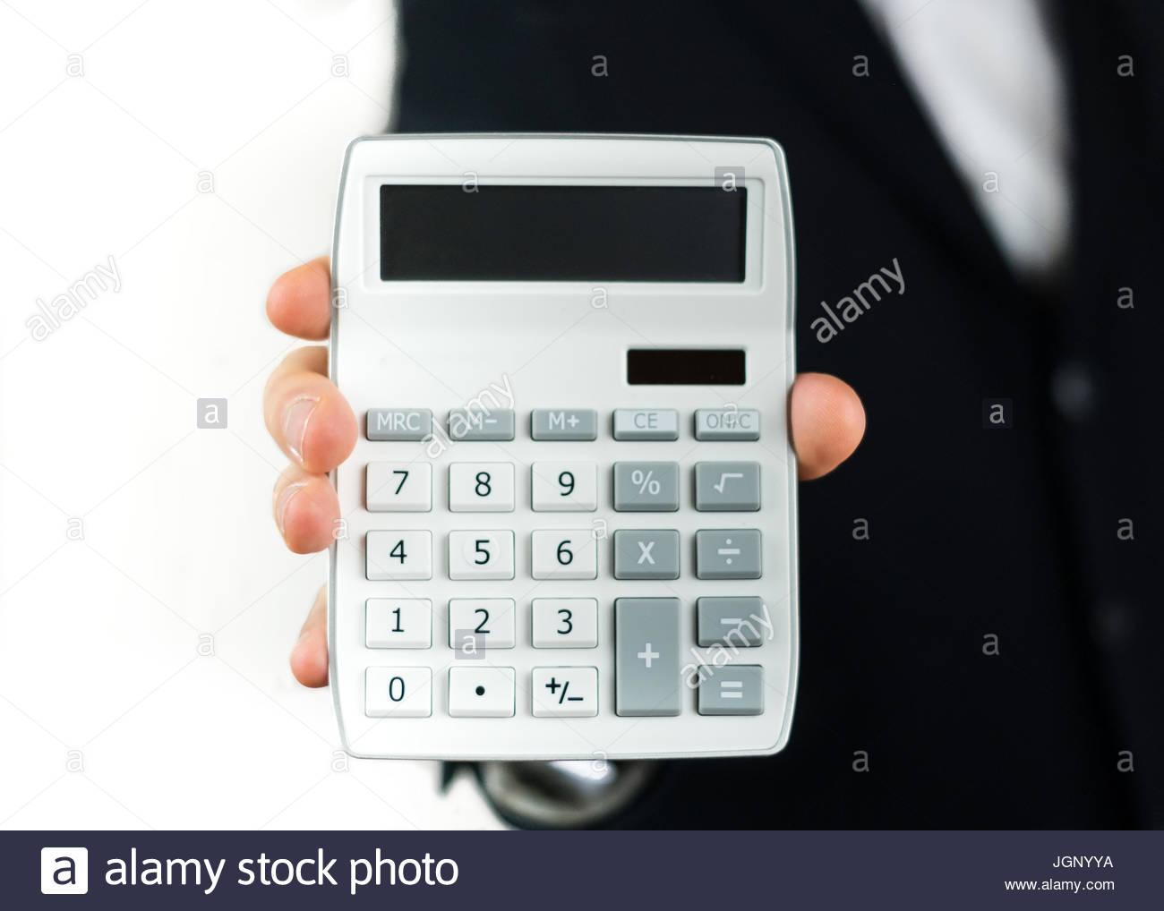 Geschäftsmann mit einem Taschenrechner Stockbild