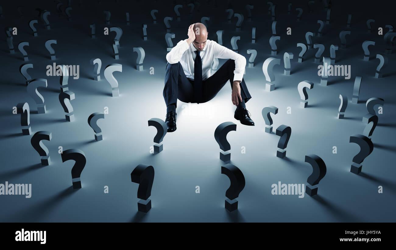 Geschäftsmann mit vielen Fragezeichen. Konzept des Scheiterns und problem Stockbild