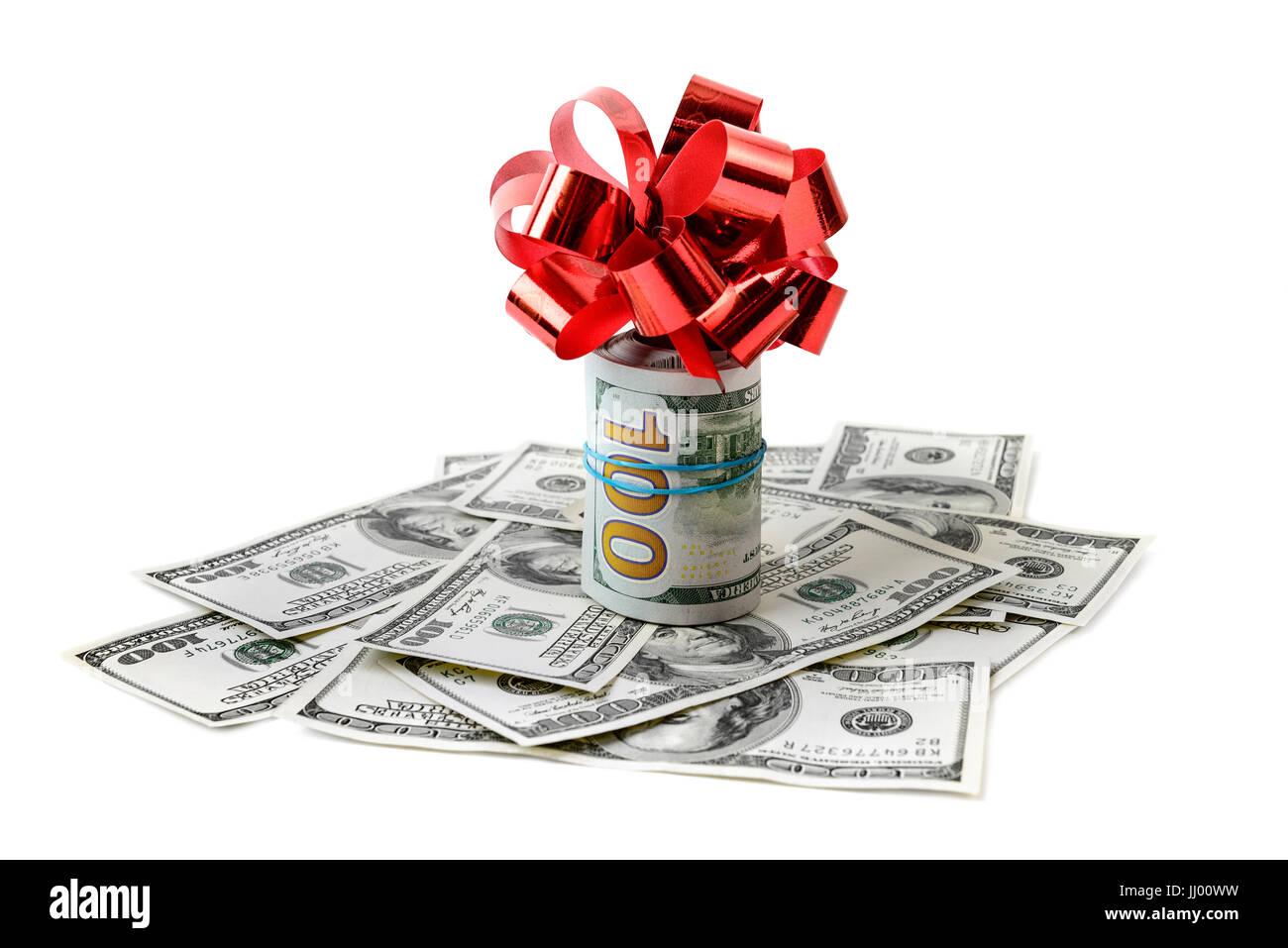 Dollar mit roter Schleife isoliert auf weiss Stockbild
