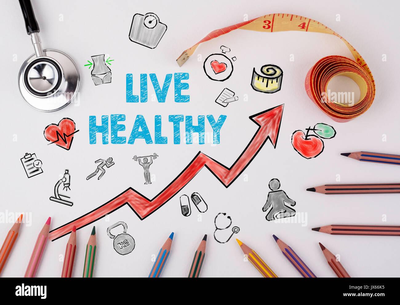 Gesund leben Konzept. Gesunder Lebensstil Hintergrund. Stethoskop auf einem weißen Tisch Stockbild