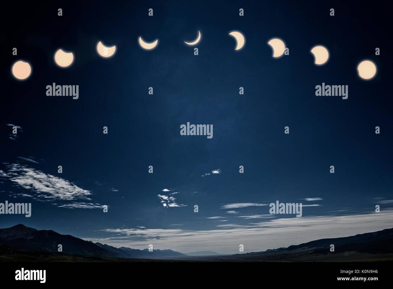 Foto der 12:00 Uhr Sonnenfinsternis; der Mond zwischen Erde und Sonne Stockbild