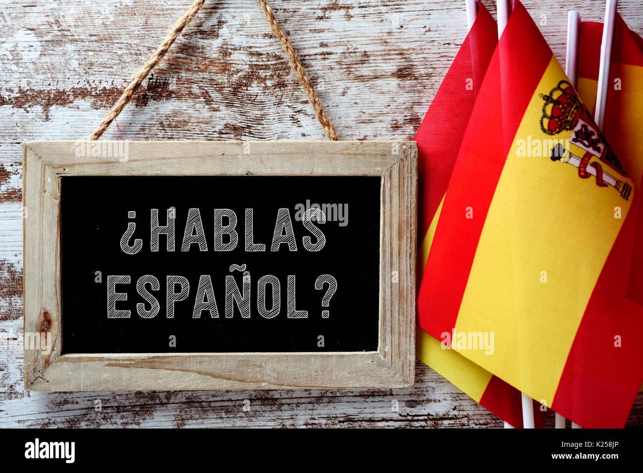 Eine hölzerne - schiefertafel mit der Frage gerahmte hablas Espanol ...