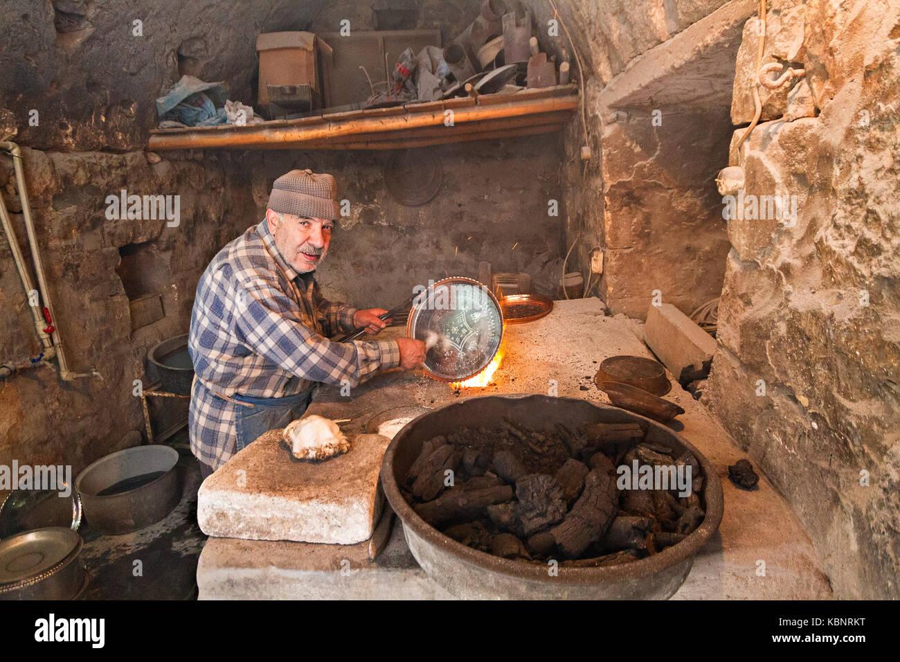 Mann für Kupfer mit Zinn. Stockbild