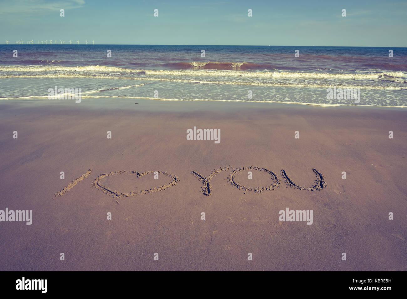 Wort oder Zeichen am Strand Sand gezeichnet Stockfoto