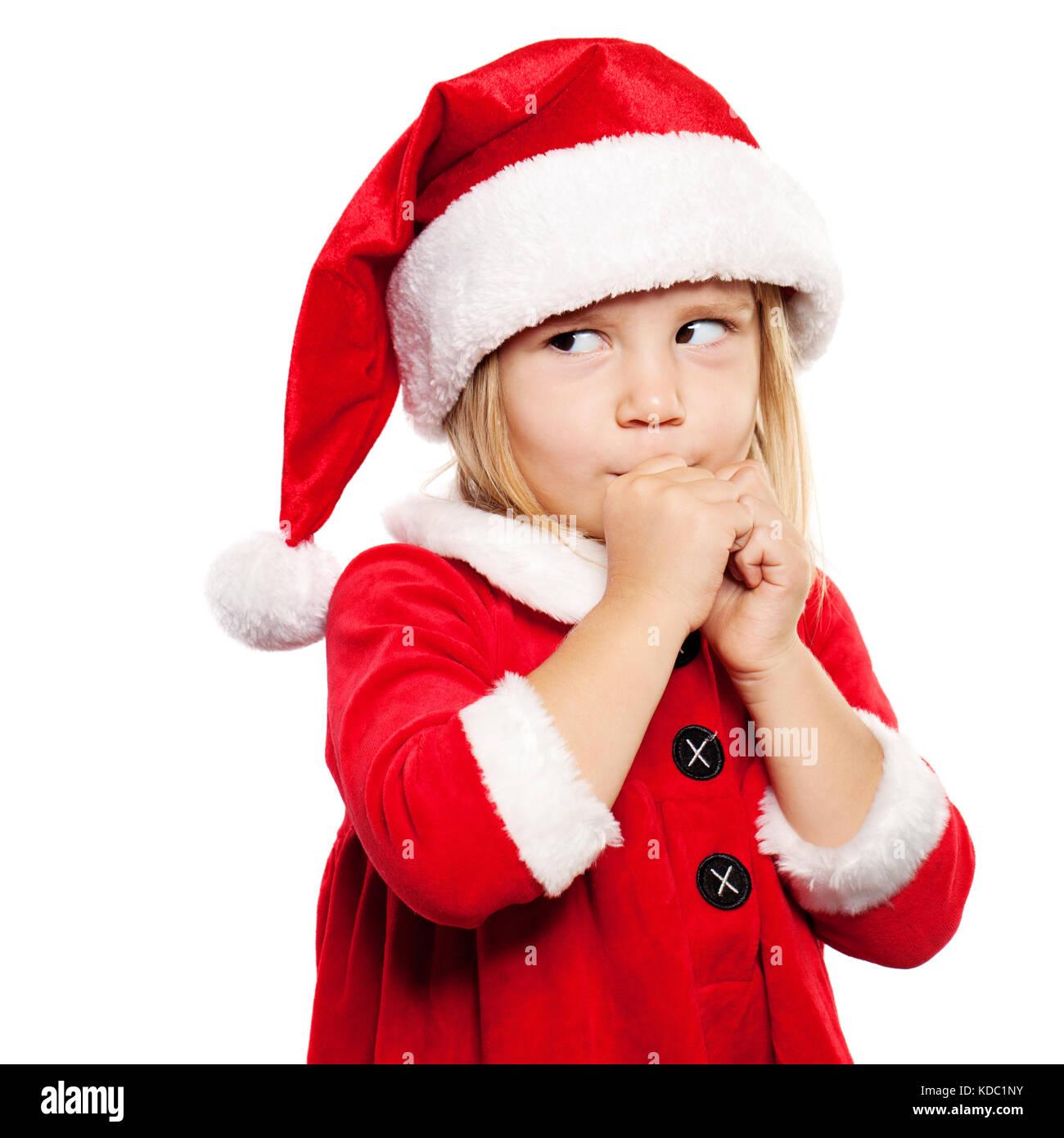 Kleines Mädchen in santa hut Traum auf Geschenke Weihnachten Kind ...