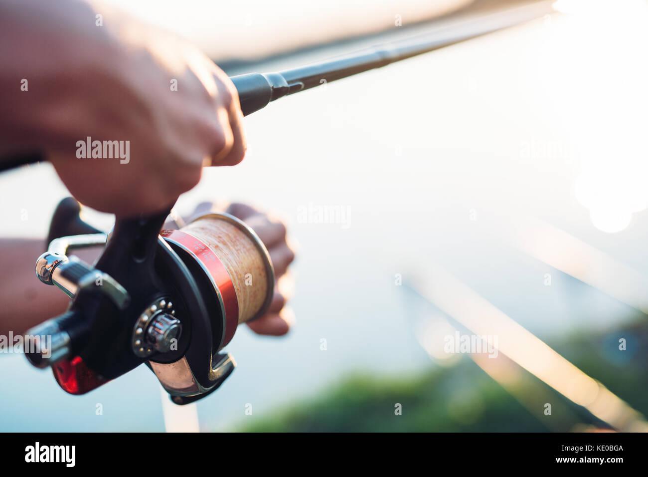 Angeln, Hobby- und Freizeit-Konzept - Fischer Stockbild