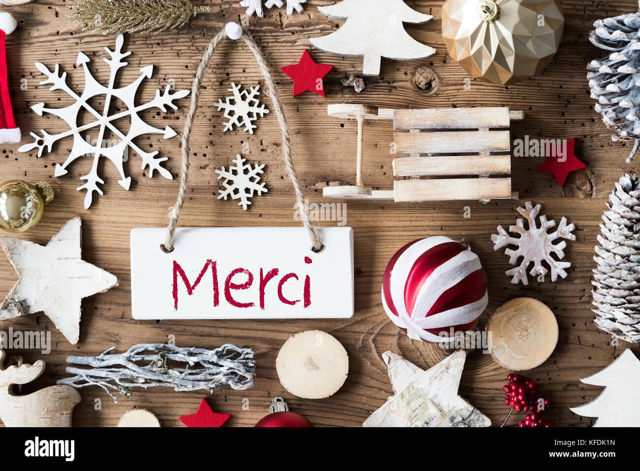 Namensschild mit französischen Text merci bedeutet Danke ...