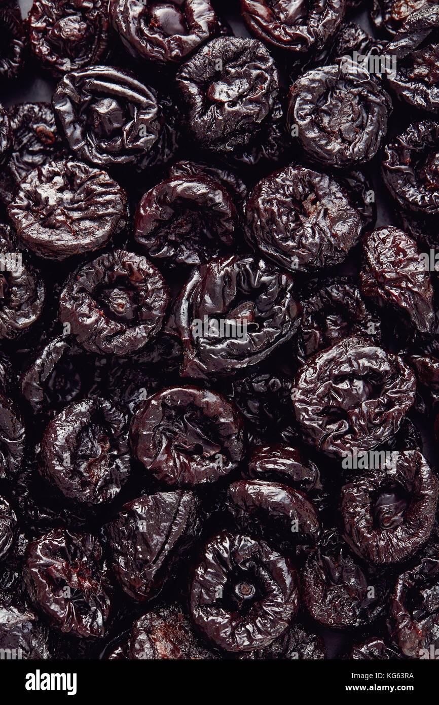 Getrocknete Pflaumen oder Pflaumen Früchte Hintergrund Textur Stockbild