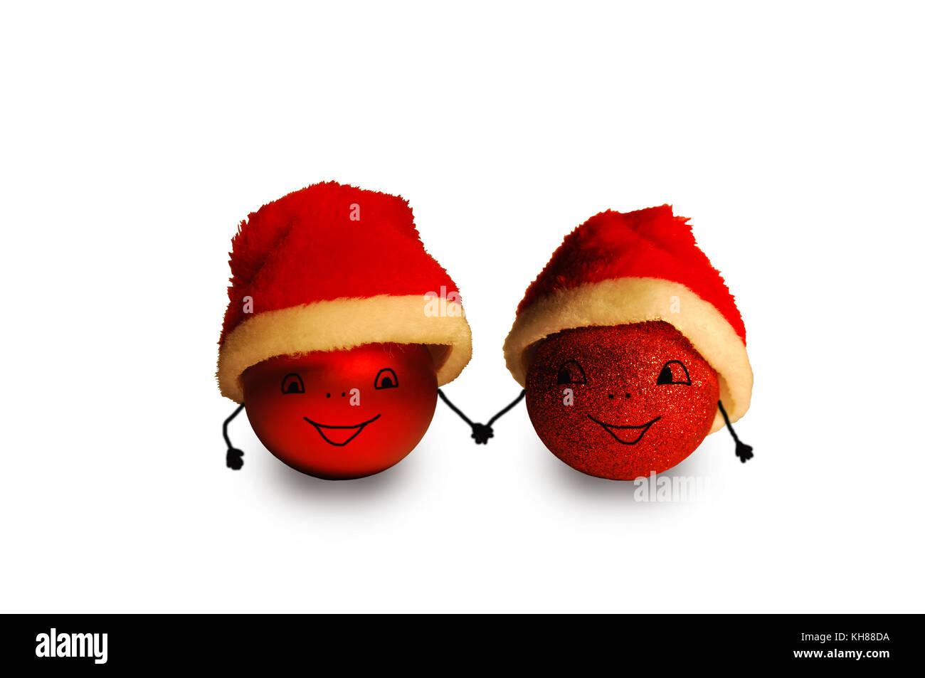 Lustige Weihnachtskugeln.Zwei Rote Weihnachtskugeln In Santa Claus Hüte Mit Bemalten