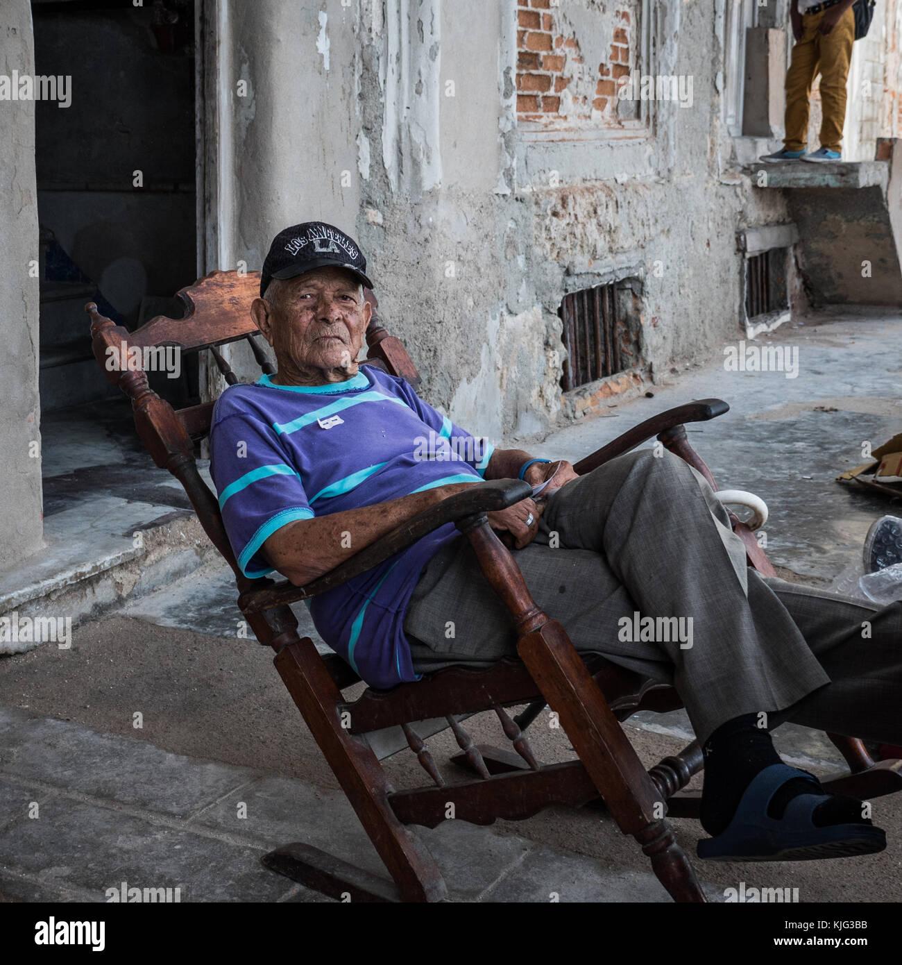rocking chair elderly stockfotos rocking chair elderly bilder alamy. Black Bedroom Furniture Sets. Home Design Ideas
