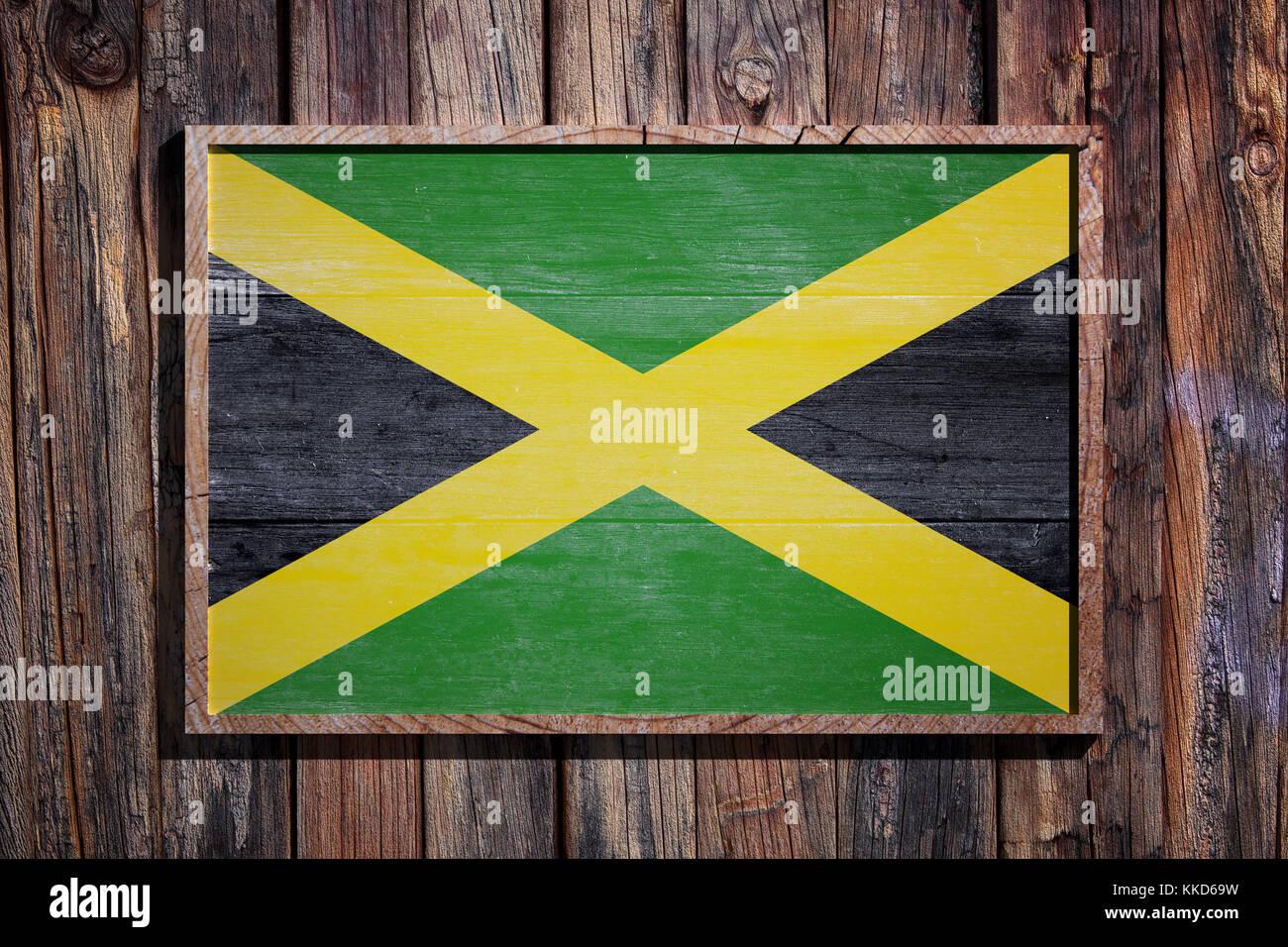 3D-Rendering von Jamaika Flagge auf einem Holzrahmen über einen ...