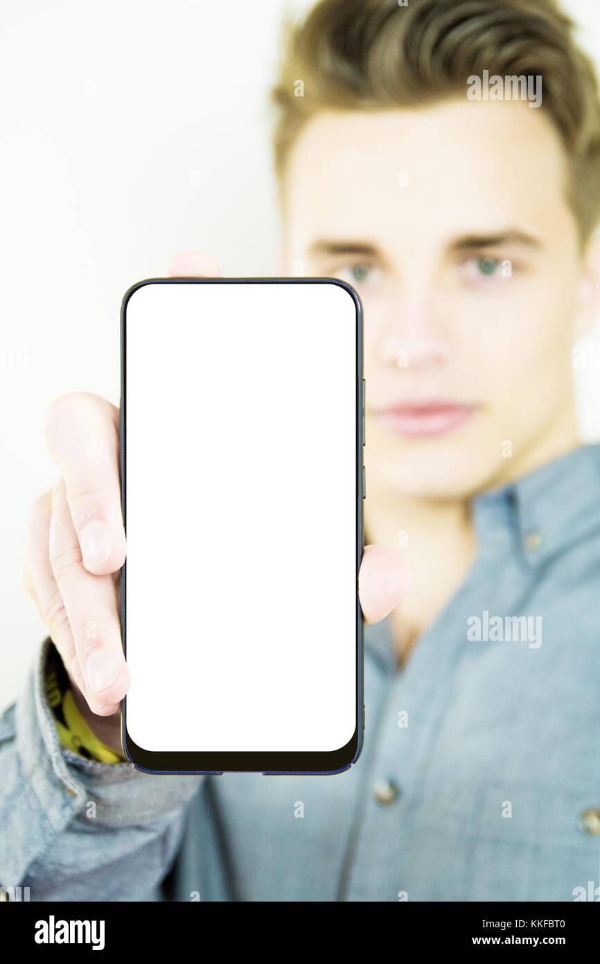Stattliche tausendjährigen zeigen generische Leer full screen Smartphone Stockbild