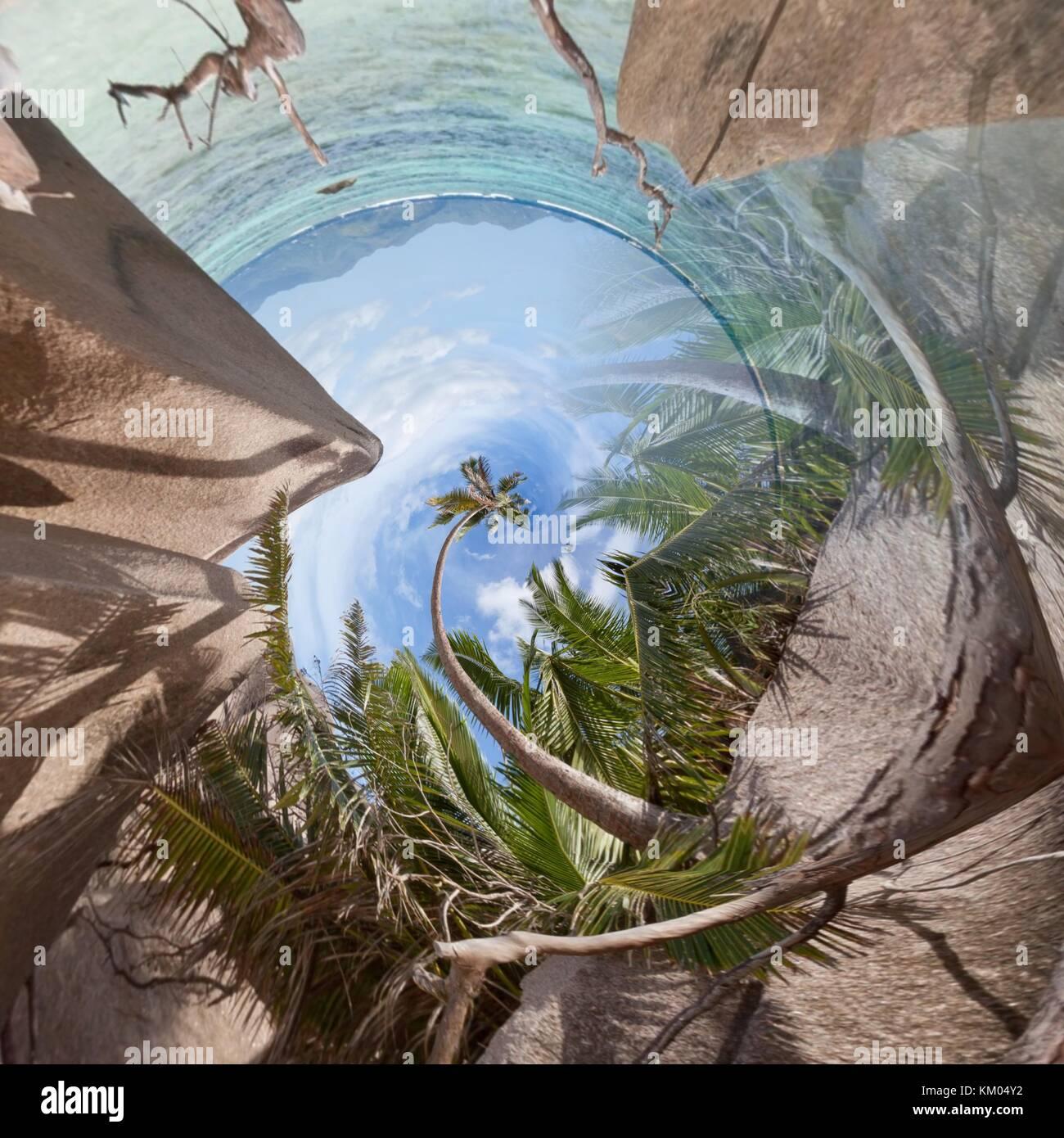 Liegen am Strand von La Digue aus einem winzigen Perspektive Stockfoto