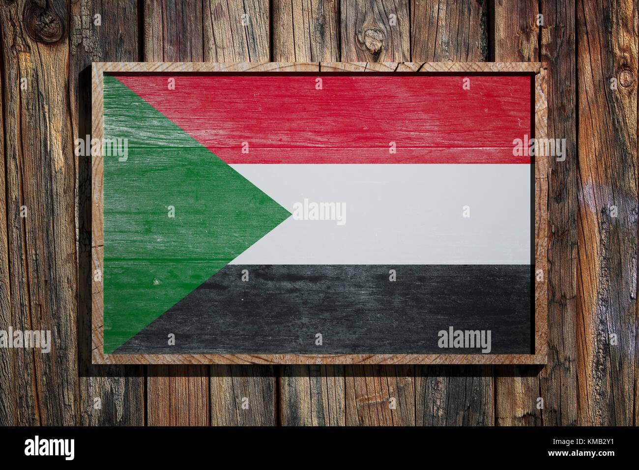 3D-Rendering von Nord Sudan Flagge auf einem Holzrahmen über einen ...