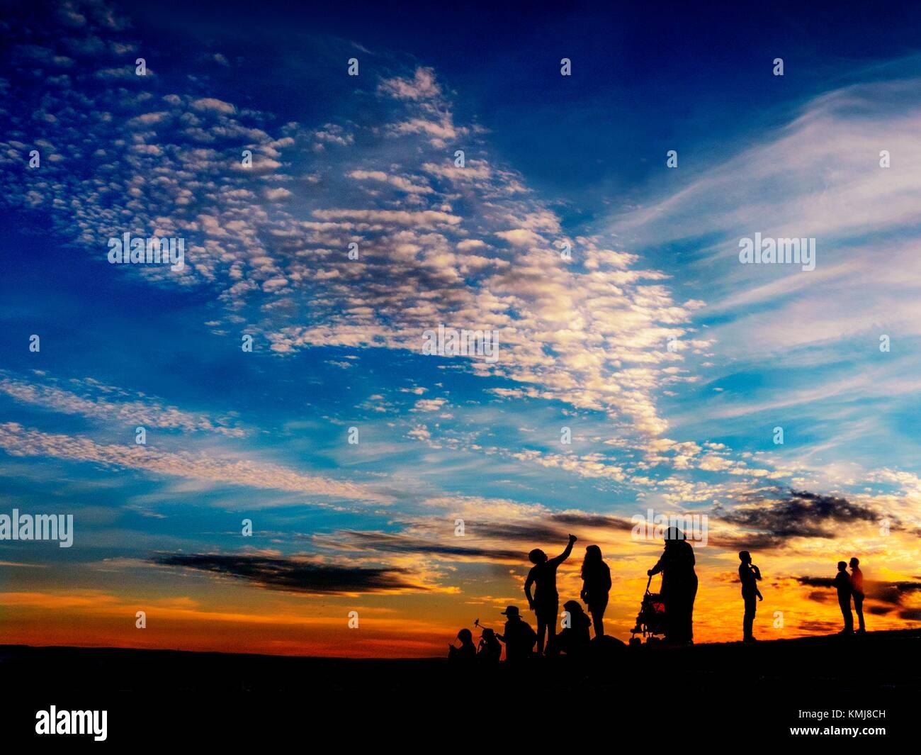 Silhouetten bei Sonnenuntergang. Marokko Stockbild