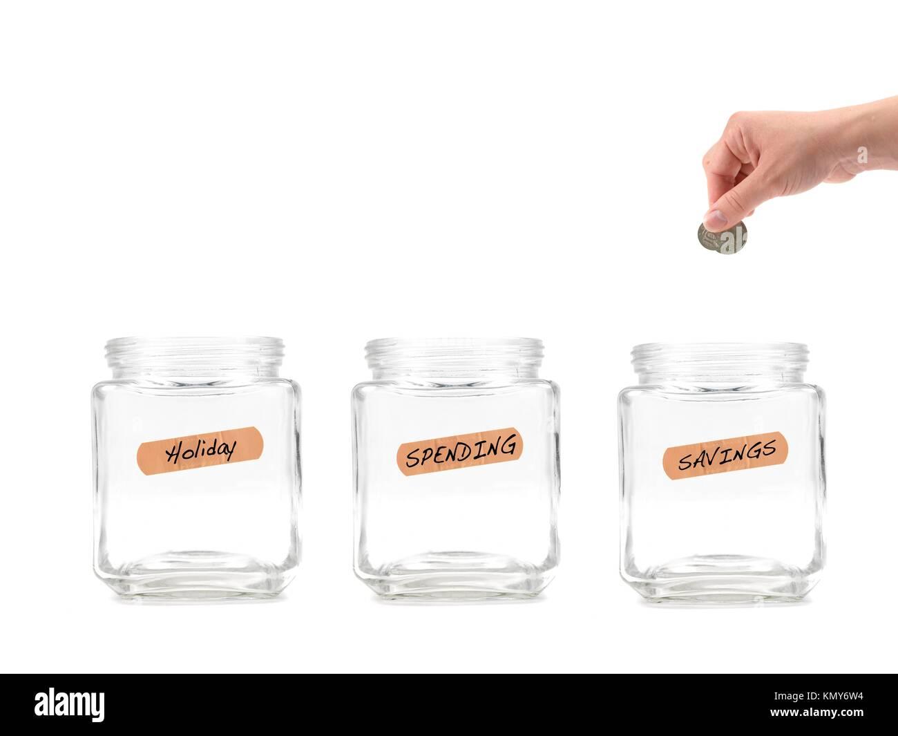 Leere Geld Gläser für die Rettung vor einem weißen Hintergrund isoliert Stockbild